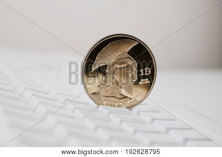 Digital currency physical gold titan bitcoin on white computer keyboard. poster