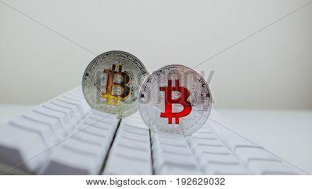 Colorful Bitcoins On Keyboard