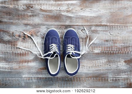 Blue Sport Shoes On Grey Wooden Table