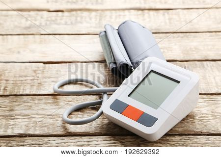 White Electric Tonometer On Brown Wooden Table