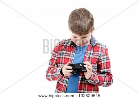Young Boy With Camera On A White Background