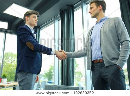 Business handshake. Two businessman shaking hands in the office