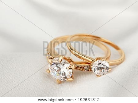 jewelry rings with diamond on white cloth