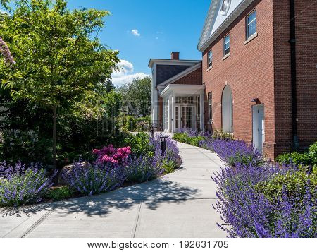 Brick building in Stockbridge massachusetts with path surrounded by flowers