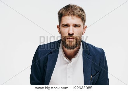 Business man with a beard, business man, business man on a light background.