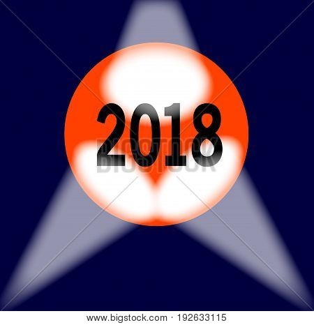 A spotlit globe with the year 2018 in large numbers.
