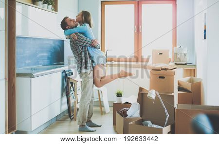 Portrait of young couple moving in new home