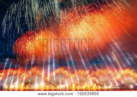 Abstract colored firework with the rays of light directed to the sky