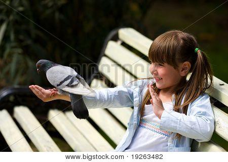 Girl Feeding Pigeon