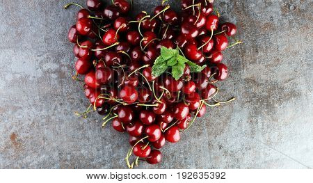 Sweet Cherry Background With Heart Shaped Cherries