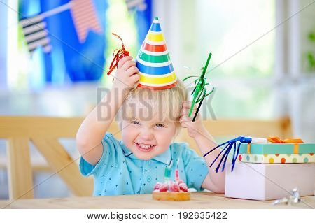 Cute Little Boy Celebrate Birthday Party With Colorful Decoration And Cake