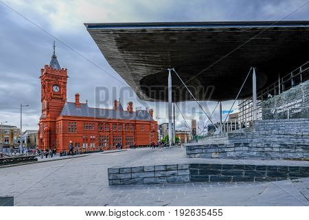 Cardiff Bay Cardiff Wales - May 20 2017: Sinedd National Assembly building and Pierhead builidng. View looking towards Pierhead Building.