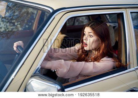 Woman driving a car, woman in a car, a car.