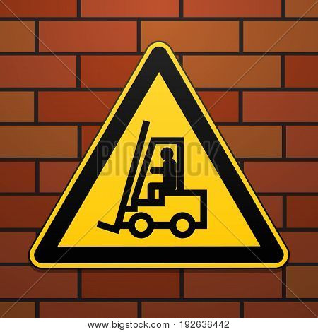 International safety warning sign. Carefully lift truck The sign on the brick wall background. Black image on a yellow triangle. Vector illustration.
