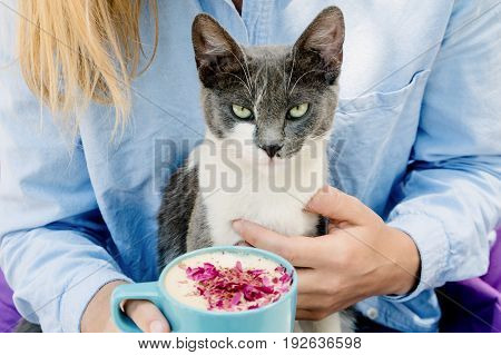 Blonde Girl In Jeans Shirt Holding A Blue Cappuccino Cup And Play With Cute Cat