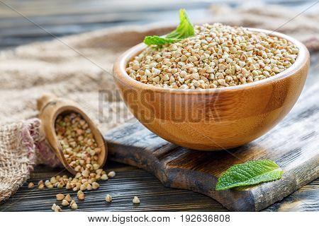 Wooden Bowl Of Green Buckwheat.