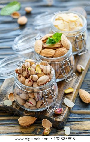 Almond Flakes, Pistachios And Almonds In The Jars.