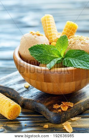 Caramel Ice Cream And Mint Leaves In A Bowl.