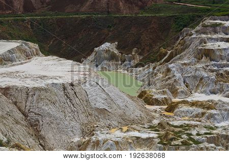 Stone quarry with excavate - Open pit mine