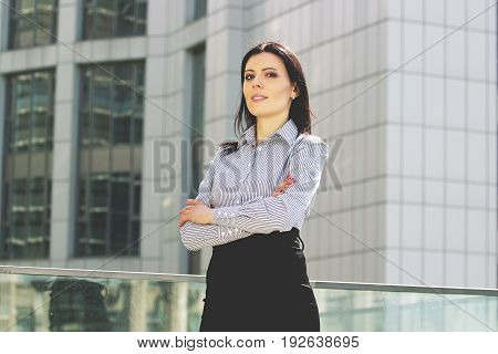 Cheerful And Confident. Portrait Of Beautiful Young Business Woman In Smart Casual Wear Keeping Arms