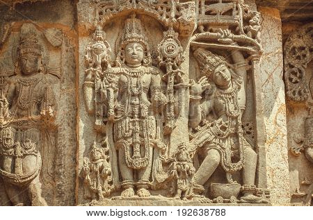 Vishnu Lord on wall of Indian temple. Example of ancient architecture 12th century decoration inside the Hindu temple Hoysaleshwara in Halebidu India