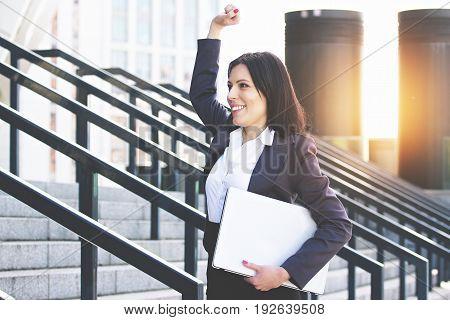 She Is A Winner. Portrait Of Happy Attractive Business Woman In Smart Casual Wear Keeping Hand Raise