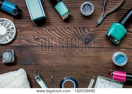 nail artist desk with manicure set and nail polish for hands care on wooden background top view mockup