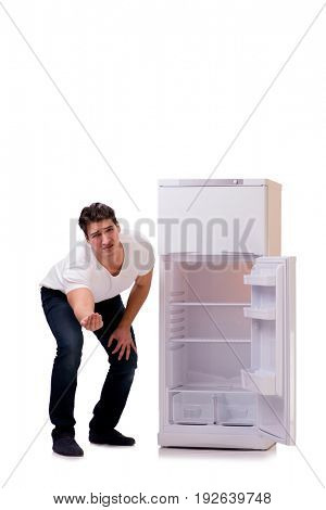 Man looking for food in empty fridge