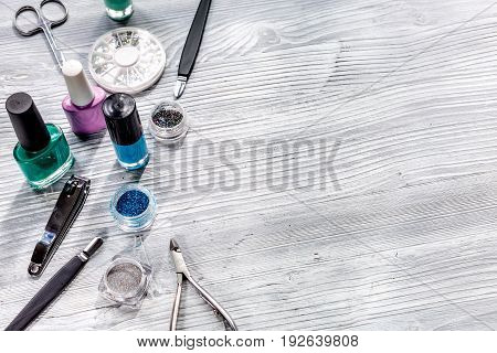 manicure preparation set with nail polish bottles on gray table background space for text