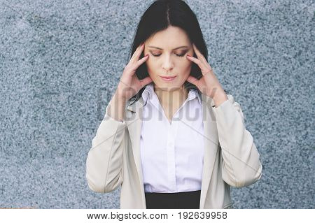 Terrible Headache. Portrait Of Looking Tired Business Woman In Smart Casual Wear Touching Her Head W