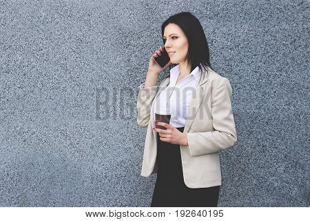 Talking About Business. Portrait Of Attractive Confident Business Woman In Smart Casual Wear Talking