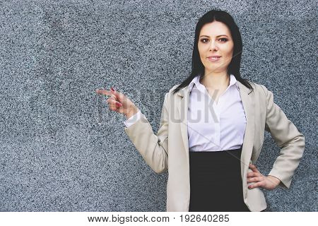 She Never Gives Bad Advices. Portrait Of Beautiful Business Woman In Smart Casual Wear Pointing Away