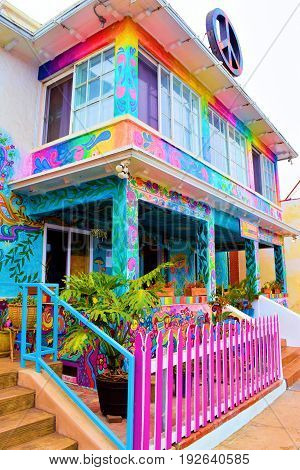 June 22, 2017 in Ocean Beach, CA:  Hosteling International building decorated in colorful bohemian style architectural style including a peace sign where guests can experience a hippie and liberal ambiance and lifestyle taken in Ocean Beach, CA
