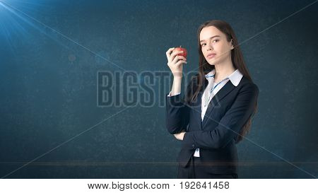 Girl In Suit Holds Bright Vibrant Apple In Hand, Symbolising New Ideas And Fresh Concepts Or Healthy