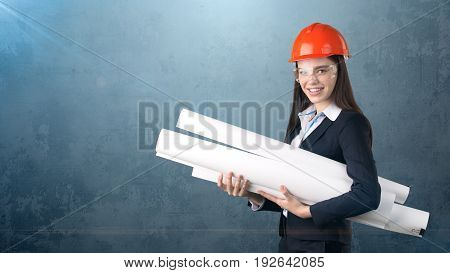 Building, Developing, Consrtuction And Architecture Concept -businesswoman In Orange Helmet, Glasses