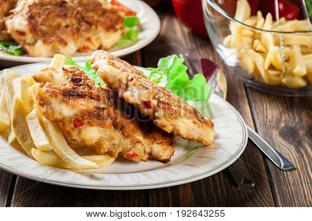 Chicken Medallions With Red Peppers Served With Chips