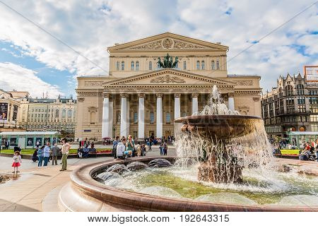MOSCOW, RUSSIA - JUNE 2017: Fountain and Bolshoi Theater during summer day. Moscow famous landmark.