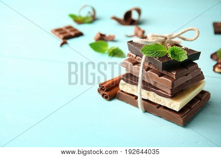 Tied chocolate pieces with mint on table