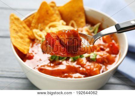 Spoon with delicious chili turkey, closeup