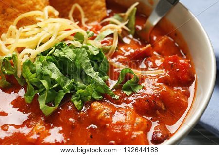 Delicious chili turkey with herbs and grated cheese, closeup