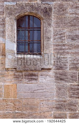 Medieval stone wall with barred window background