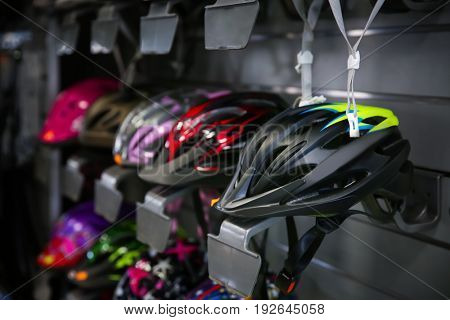 Bicycle helmets on shelves in sport shop