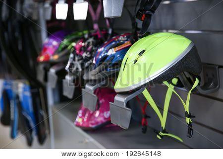 Bicycle helmets on shelves in sport shop