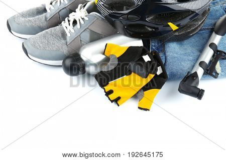 Bicycle accessories and biking clothes on white background