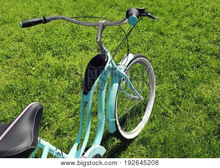 Bicycle on green grass background