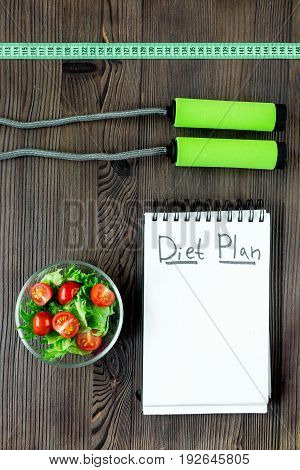 Tasty food for slimming. Notebook for diet plan and fruits on wooden table top view mock up.