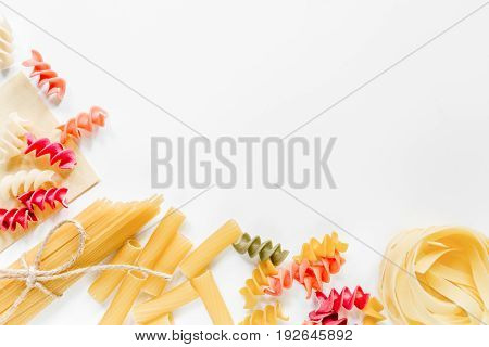 Italian food concept various kind of pasta on white background top view copyspace.