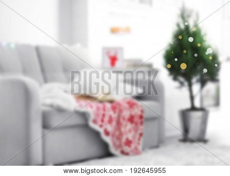 Blurred view of couch and Christmas tree. Happy New Year 2018