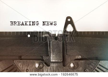 Breaking news written on a vintage typewriter