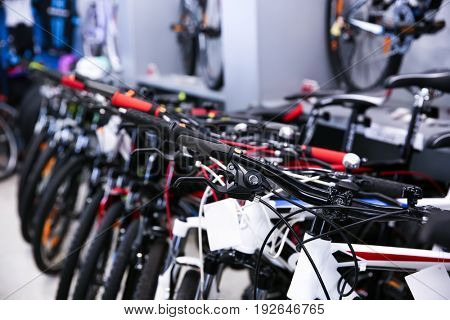 Modern new bicycles in shop
